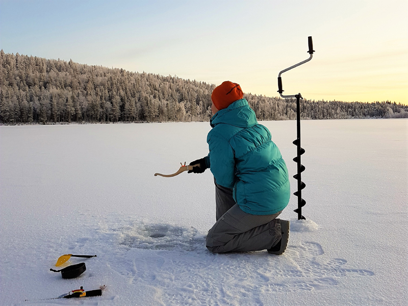 Ice Fishing by the Arctic Circle
